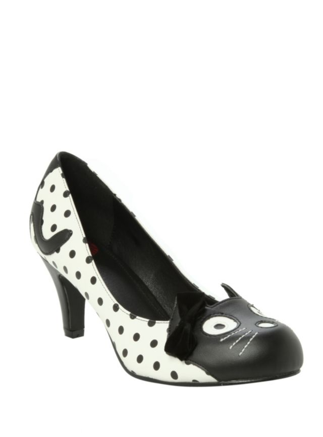 White heels with black polka dots, kitty character face and a little black bow.