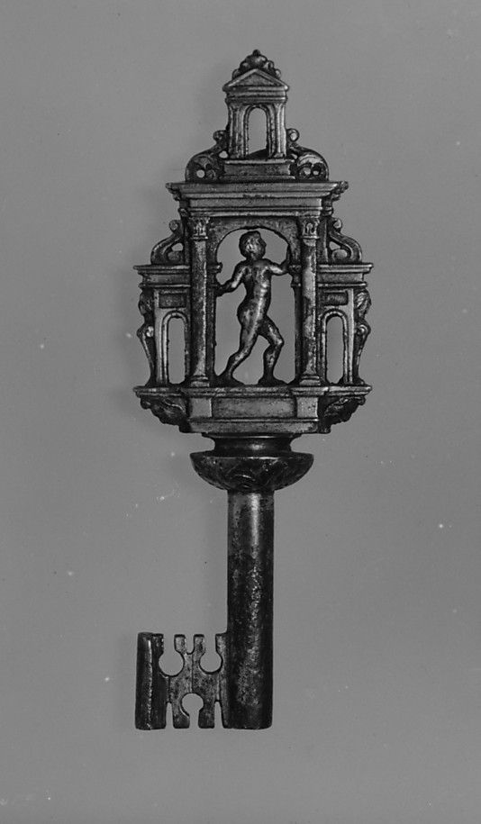 Featuring a bow in the form of a classical structure inhabited by a twisting nude male figure, this key was based on a design by the engraver and architect Jacques Androuet du Cerceau (1510/12–1585), published in his book of models for locks.