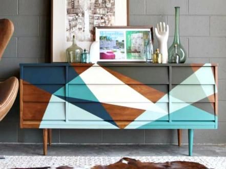 Angular+paint+patterns+were+used+to+cover+up+some+damaged+spots+on+this+1950s+credenza.+Sections+without+damage+were+left+as+is+to+show+off+the+beautiful+pecan+wood+grain.+See+how+it+was+done+>>