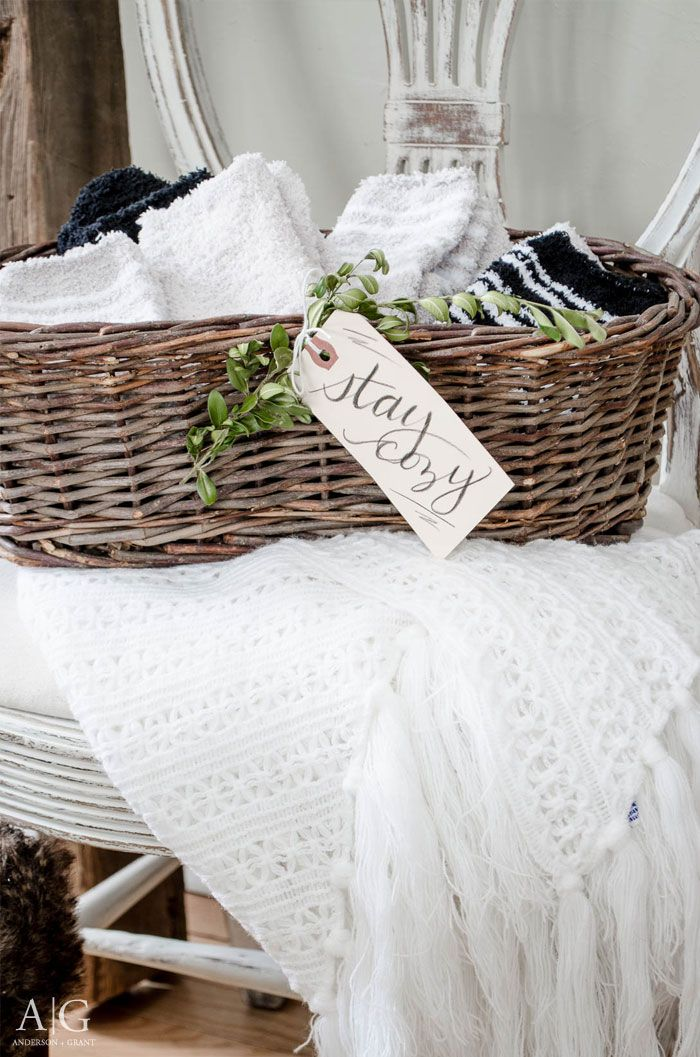 Fill a basket with heavy socks or slippers for your guests to wear while  they visit your home.  3bcf91fe8