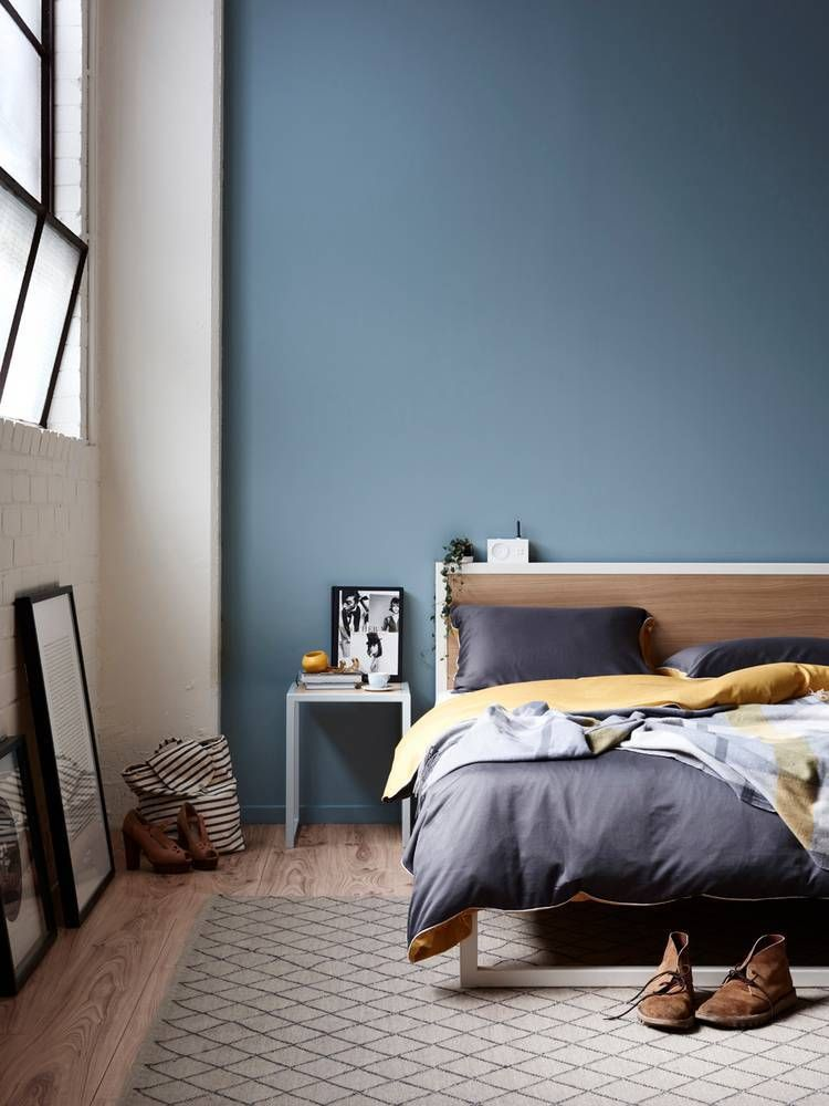 A Captivating Blue Hue Sets Fearless Backdrop For This Dreamy Bedroom Accentuated By The Two Toned Paint Scheme Natural Wood Flooring And Streamlined