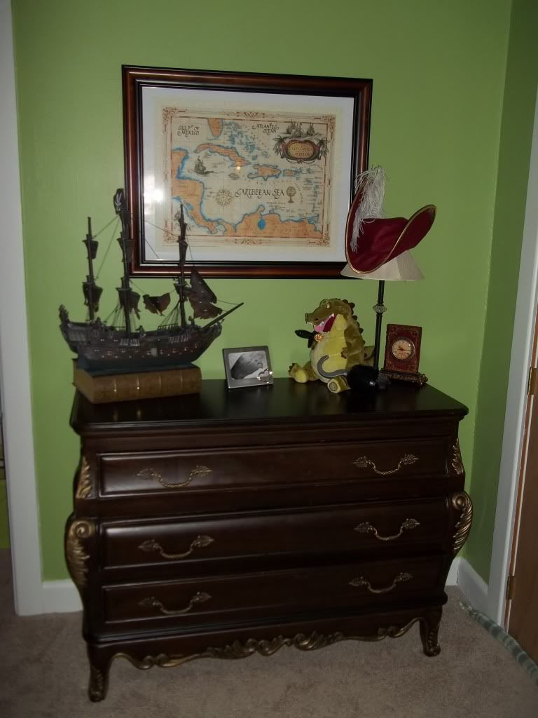LOVE this styled dresser area in a Peter Pan themed nursery. The ship and map are too cute