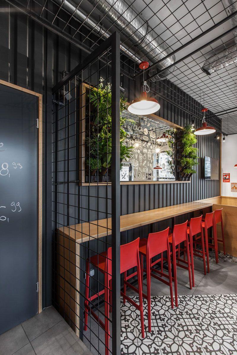 Design Detail The Walls Of This Burger Bar Are Covered In Black Corrugated Steel Coffee Shop Design Restaurant Interior Design Design