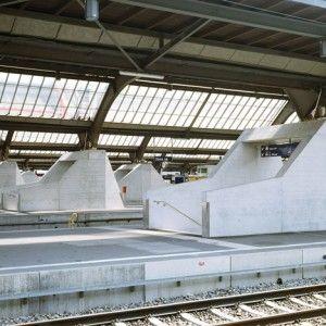 Sloping concrete circulation entrances added  to platforms at Zurich Hauptbahnhof
