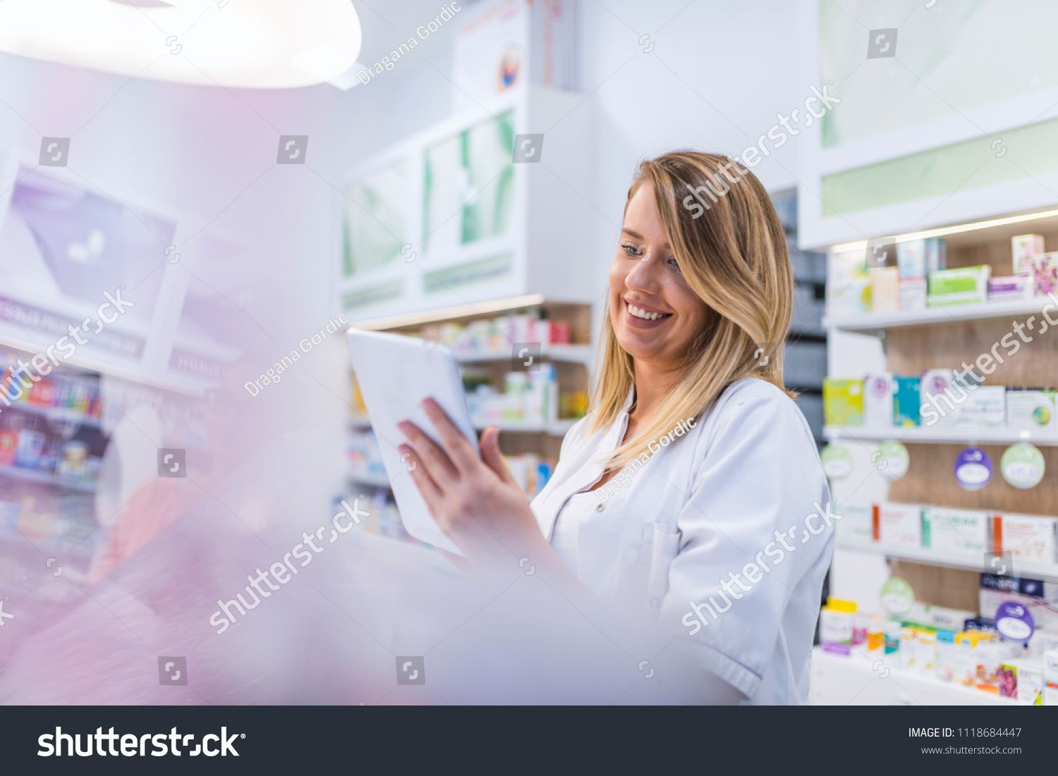 Pharmacist working with a tablet computer in the pharmacy