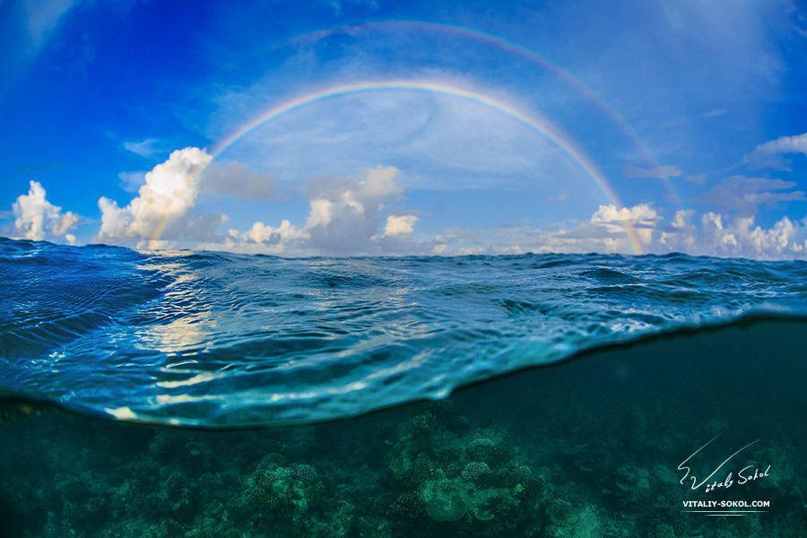 Real Rain Cloud rainbow - real. maldivian sky with clouds and rainbow jjust after