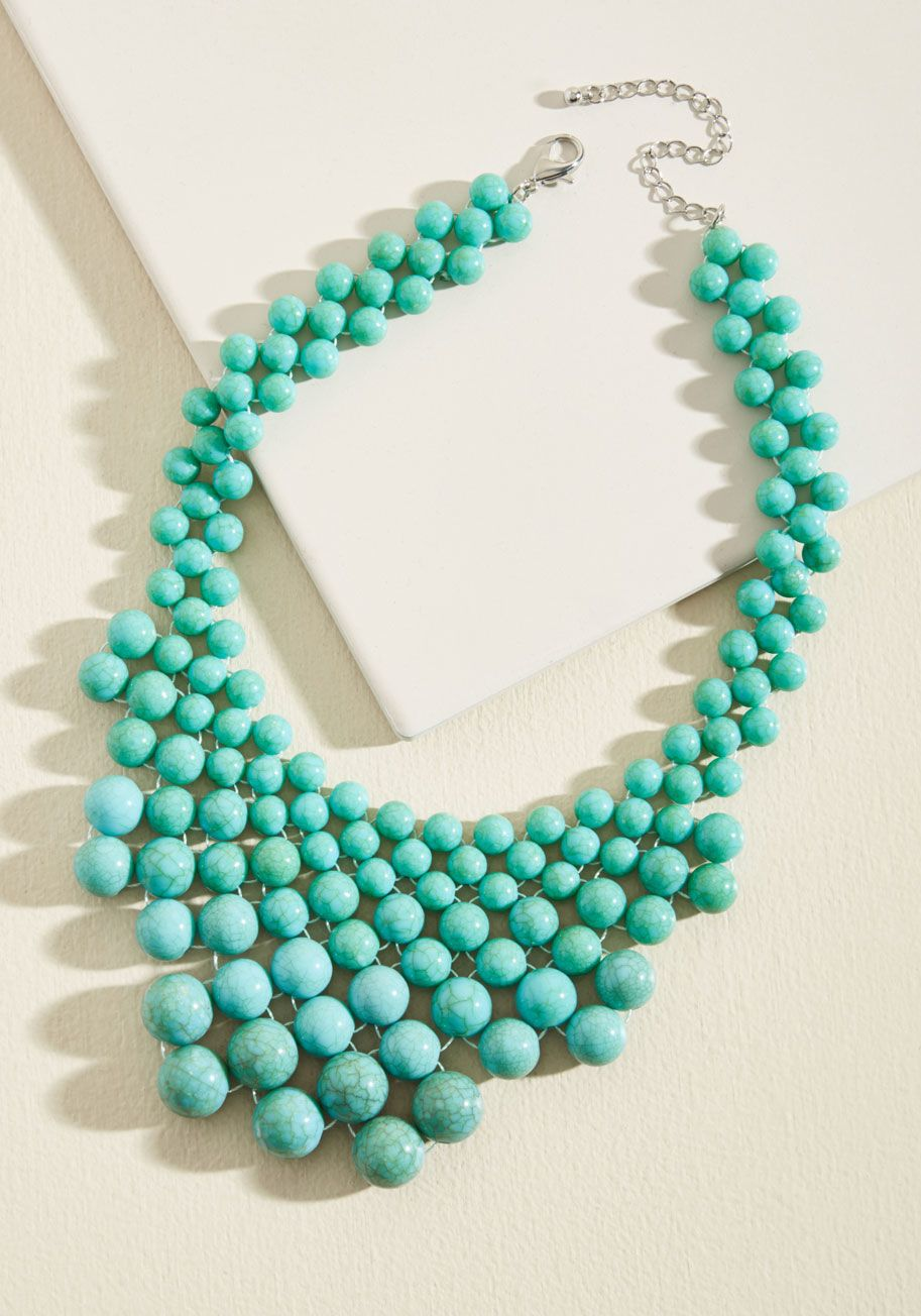 <p>Don't be surprised if flaunting this beaded necklace prompts others to express their affection for your accessorizing! In a tiered, turquoise-inspired motif, this glossy bauble creates opportunity for everyone to shower you in ensemble accolades.</p>