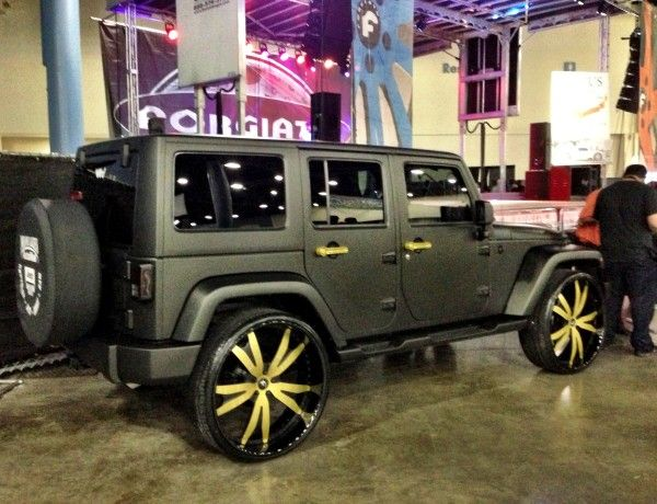 Ace Hoods newly re-done matte black Jeep Wrangler sittin on 28 gold Forgiato wheels. #acehood