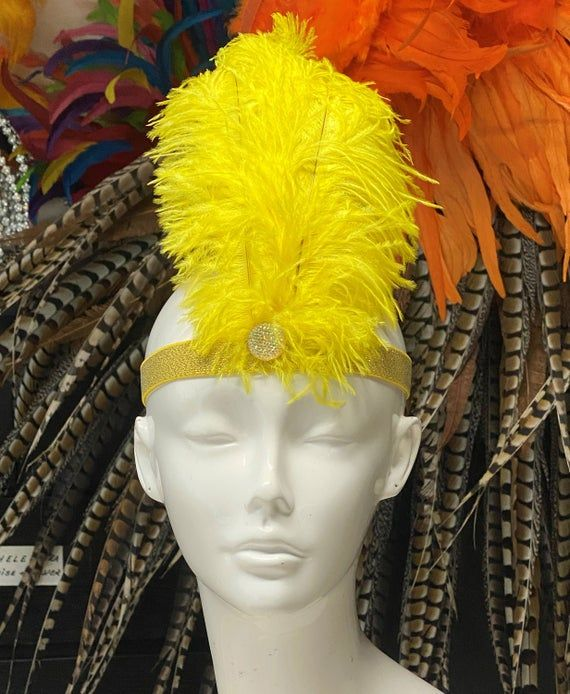 We make and ship our items really fast if you need it for a specific date please let us know. or call/text us at 954-3051817 to complete your order over the phoneSmall size simple feather headband flapperSmall stone detail in the front Easy to secure with glitter elastic headband that matches the feather colorAvailable in many colorsA miamifeathers originalAll the items are new!..................Please Note: We guarantee that we will send your item by the date our processing time says we will. B