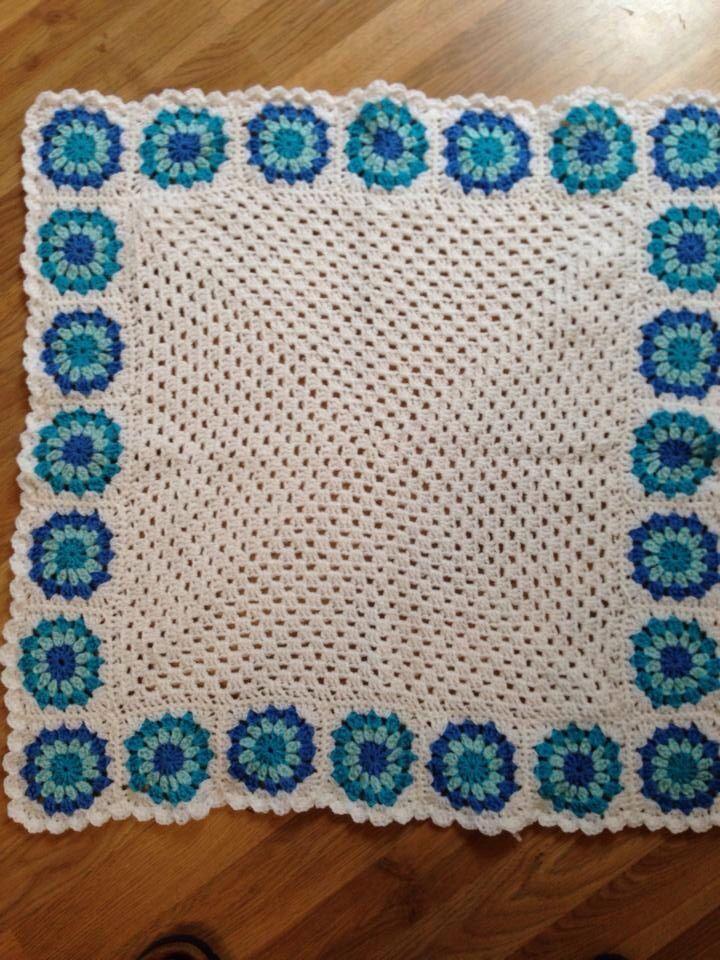Baby blanket. Big granny square edge with sunburst flower squares.