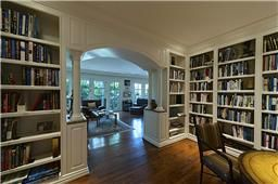 Book lined library.  I like the white wood and the arch and columns. Cozy but traditional