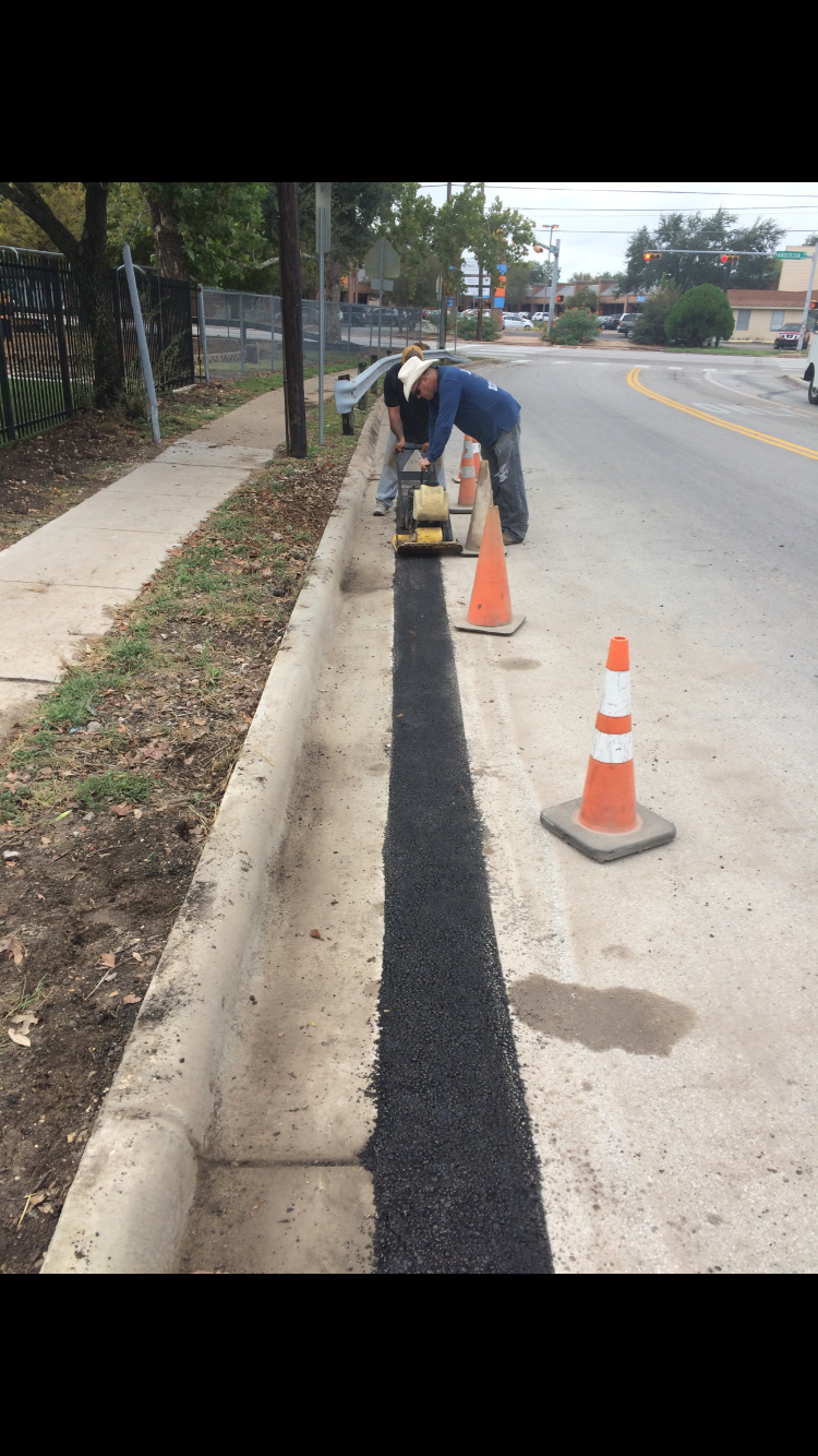 Asphalt Patch Repair For Austin Texas This Is A Curb And Gutter Patch Asphalt Patch Paver Driveway Driveway Materials
