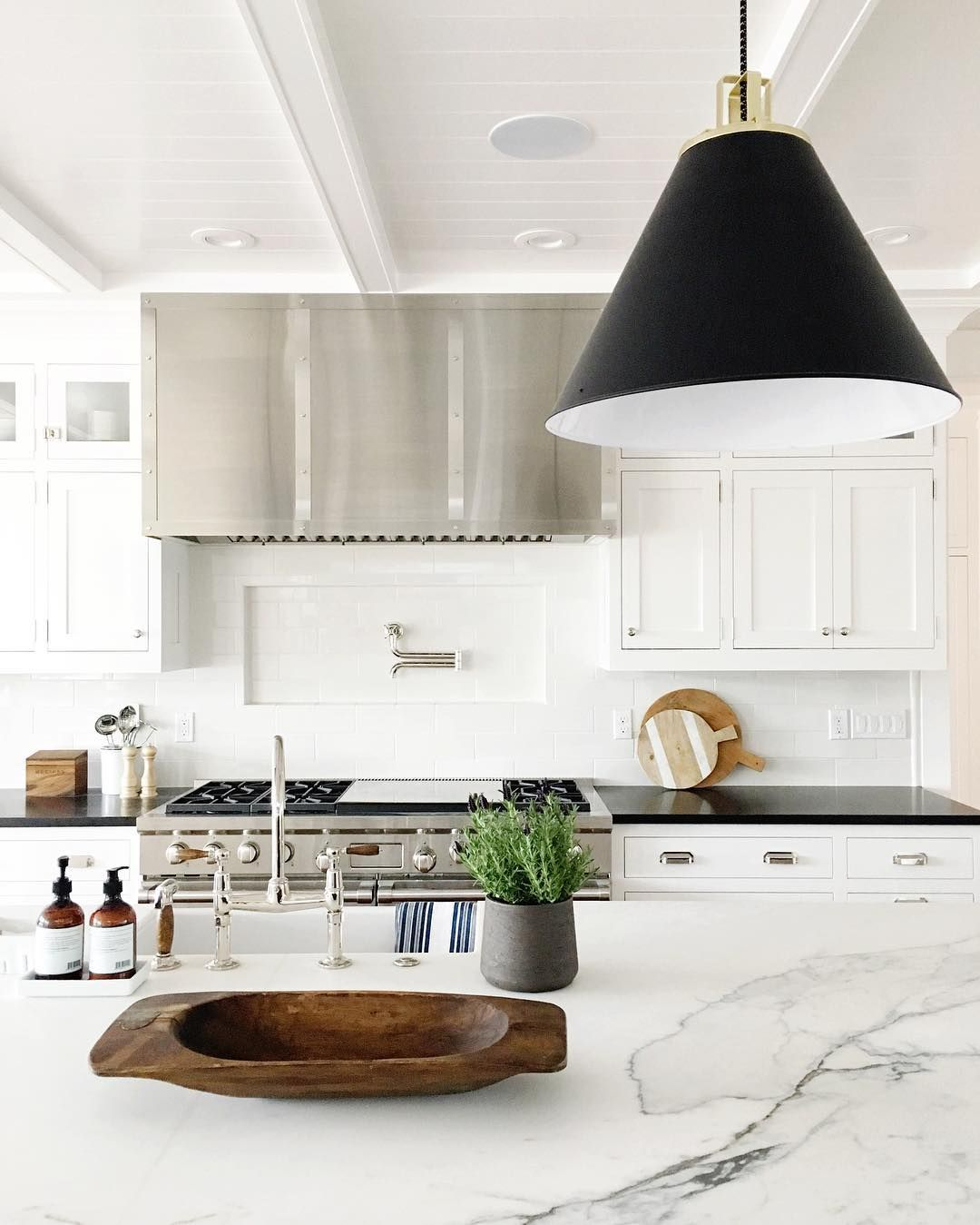 Black pendant light + marble countertop see more at www
