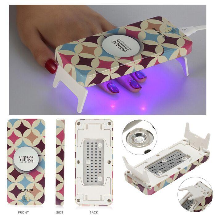 Lámpara LED Mini plegable, secado de uñas gel. Tamaño pocket, se conecta el puerto USB o la corriente. Potencia 9W. Temporizador de 30S, 60S y 90S