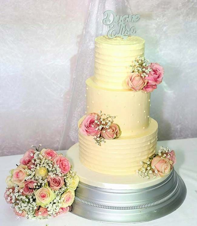 This three tiered cake from Surrey based supplier Bake Rattle N Roll is traditional yet the buttercream frosting adds texture and versatility to the tiers.
