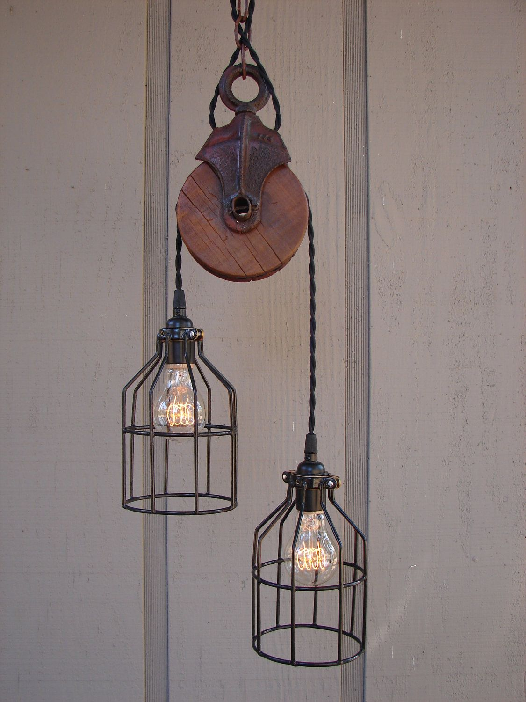 Industrial pulley pendant lights basement inspirations pinterest