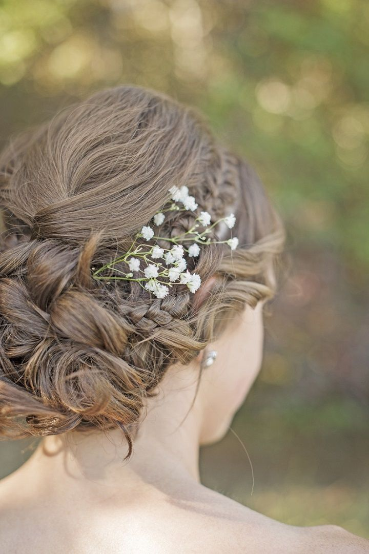 Gorgeous Braided Updo and tug a sprig of Baby's Breath in hair #weddinghair #weddinghairstyle #hairstyles