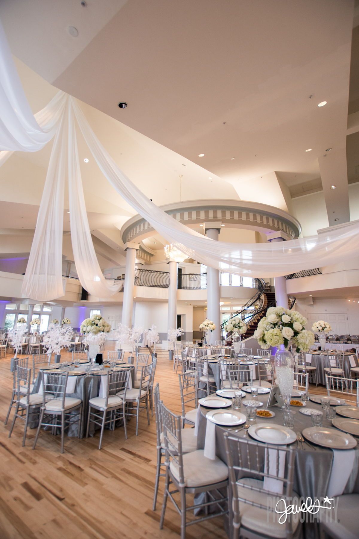 A Beautiful Reception Room Set Up And White And Silver Wedding Decor At Denver Wedding Venue The Ch Colorado Wedding Venues Denver Wedding Denver Wedding Venue