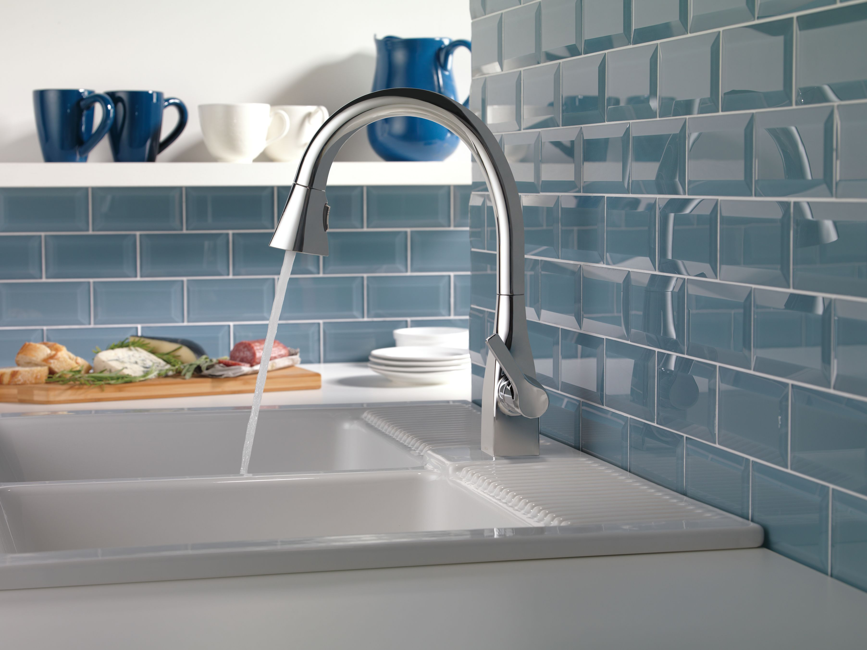 Steel blue subway tile backsplash makes this kitchen feel calm and