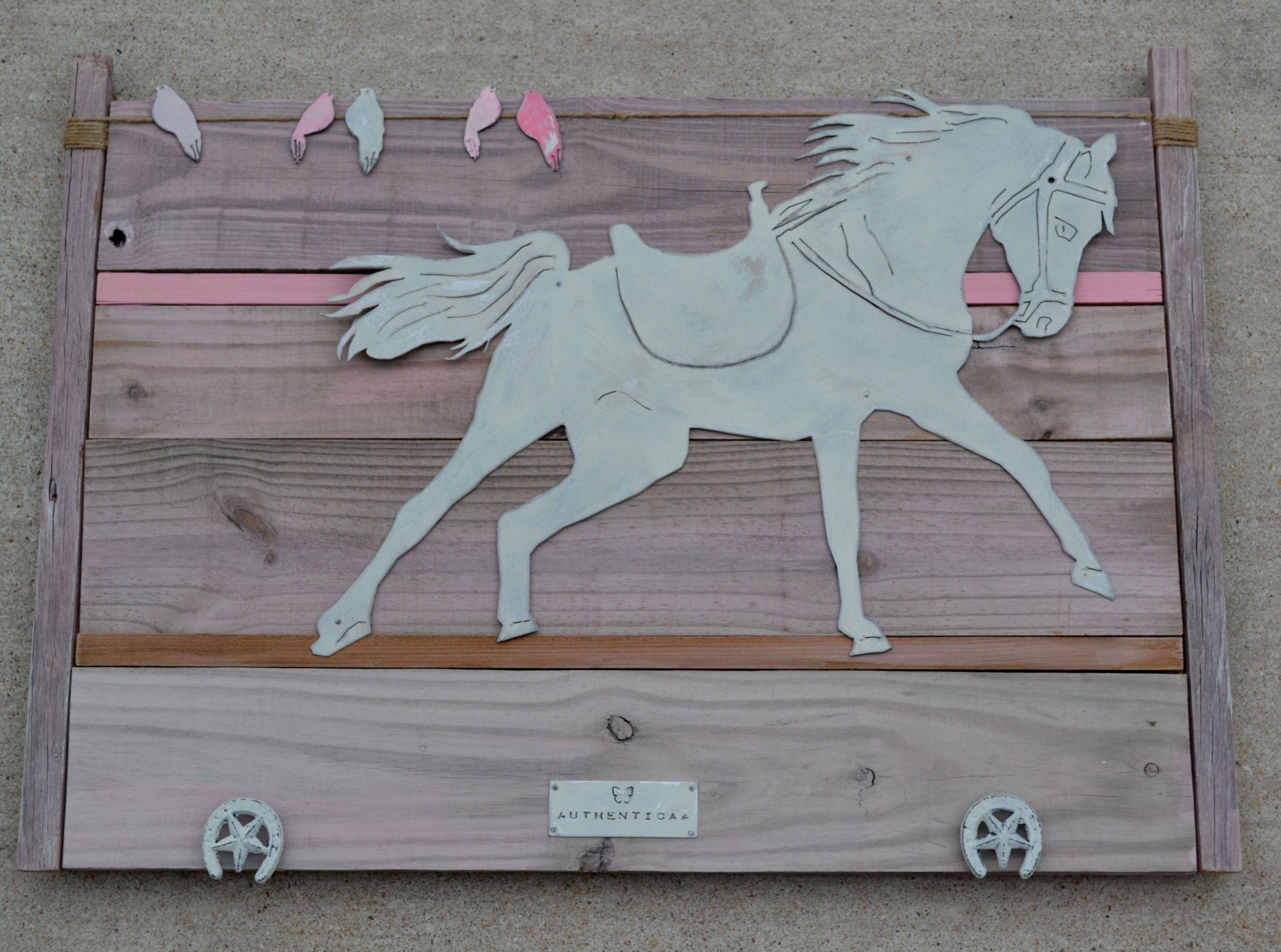 painted horse on pink wash reclaimed wood. Magnet birds resting on ...