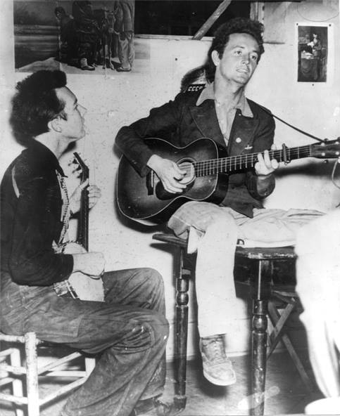 """Pete Seeger and Woody Guthrie, Oklahoma, Uncredited Photographer, c.1940   """"Again, I say I will be glad to tell what songs I have ever sung, because singing is my business.  But I decline to say who has ever listened to them, who has written them, or other people who have sung them.""""  Pete Seeger in his compelled testimony before the House Un-American Activities Committee, 1955."""