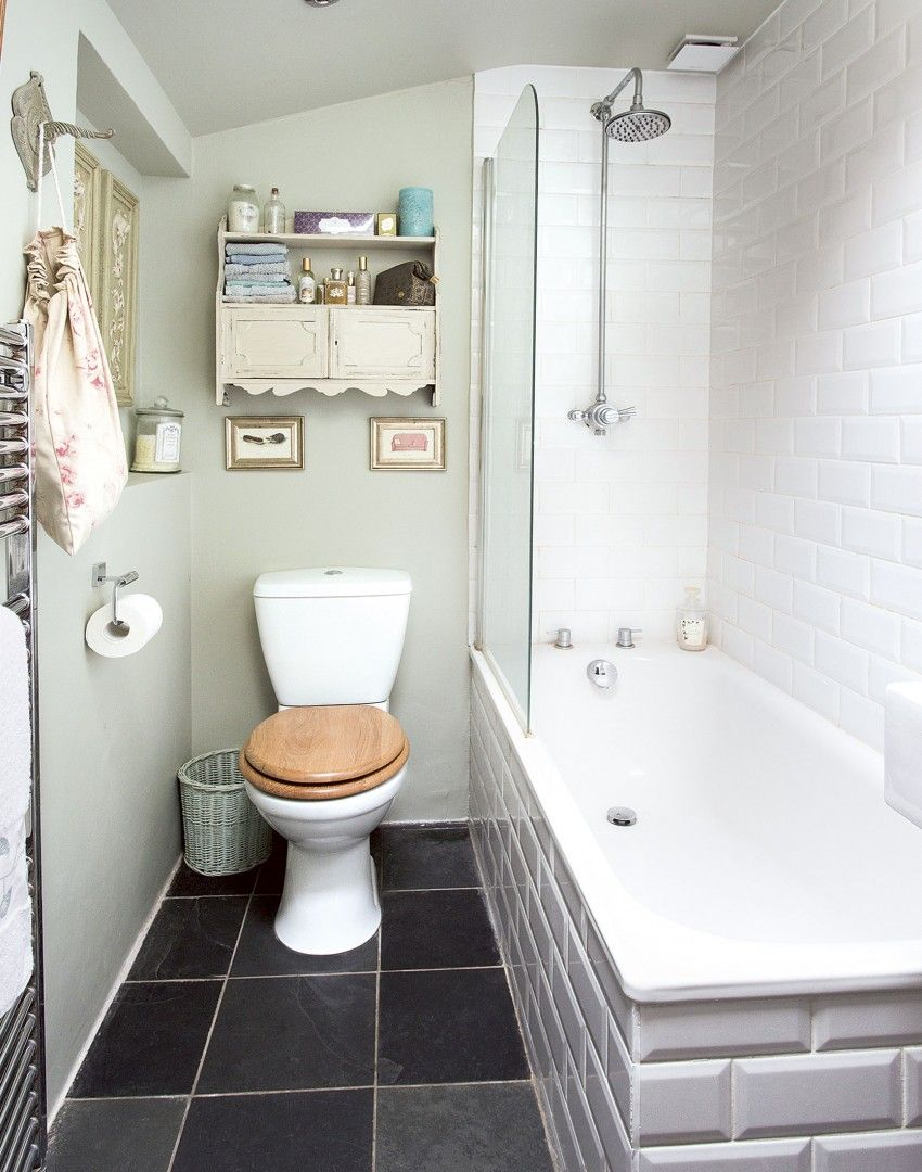 Metro-style tiles adorn the bath and shower walls in this pretty ...