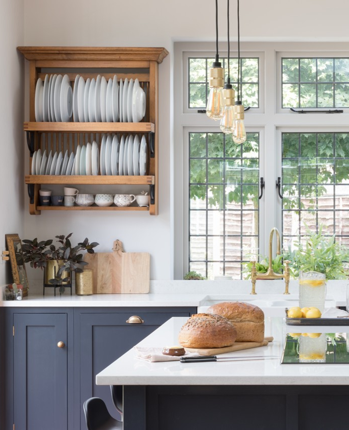 Kitchen design scheme by Alison Anderson Interiors. Pantry blue Devol kitchen, pendant lights by Buster and Punch, plate rack by Fired Earth. #plateracks