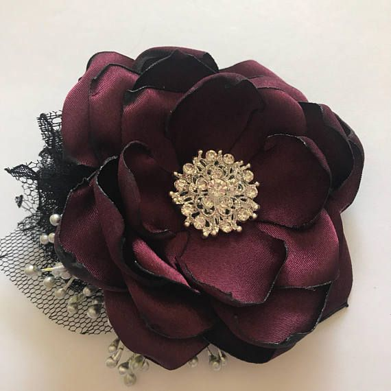 This beautiful corsage is simple in design yet beautiful as an accessory for anyone in a bridal party or going to a school dance or prom. Open wild flower with rhinestone center. Side black lace puff, silver stamen and tulle leaves. Comes on a black elastic wristband. Can be put on an adjustable fabric covered cuff or bar pin. Message me with any questions :) Thanks so much for Shopping at The Vintage Cabbage Rose