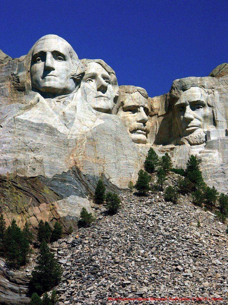 Mt rushmore is a sculpture carved into the granite face of