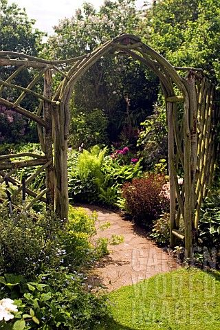 Jly957 rustic wooden arch and trellis work at whit asset details garden world images - Garden wood arches ...