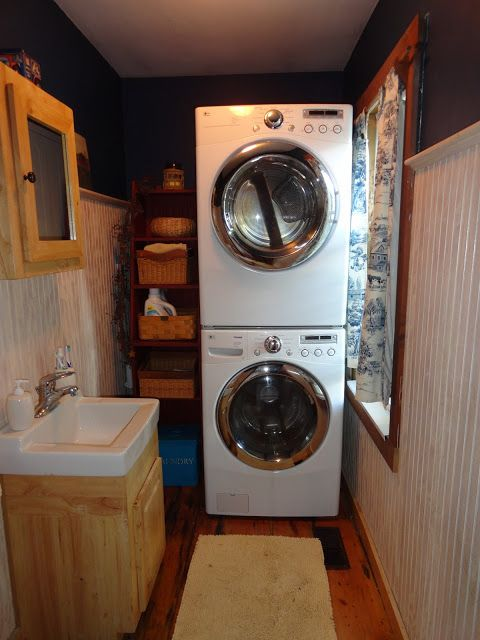 Half Bath And Tiny Laundry Space With Stacked Washer And Dryer