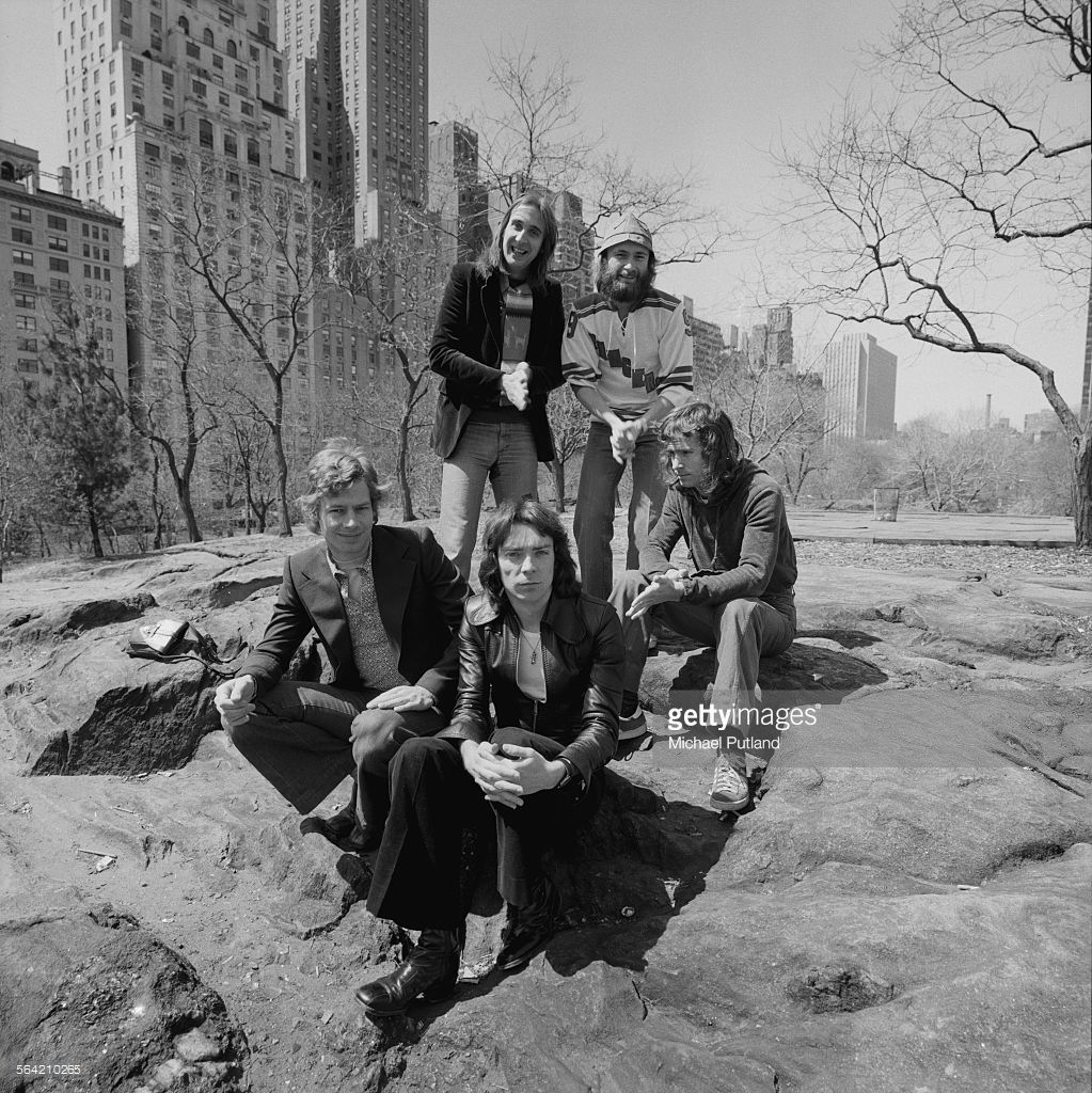 English progressive rock group Genesis in Central Park, New York City, 20th April 1976. Clockwise from front, centre: guitarist Steve Hackett, drummer Bill Bruford, bassist Mike Rutherford, singer Phil Collins and keyboard player Tony Banks.