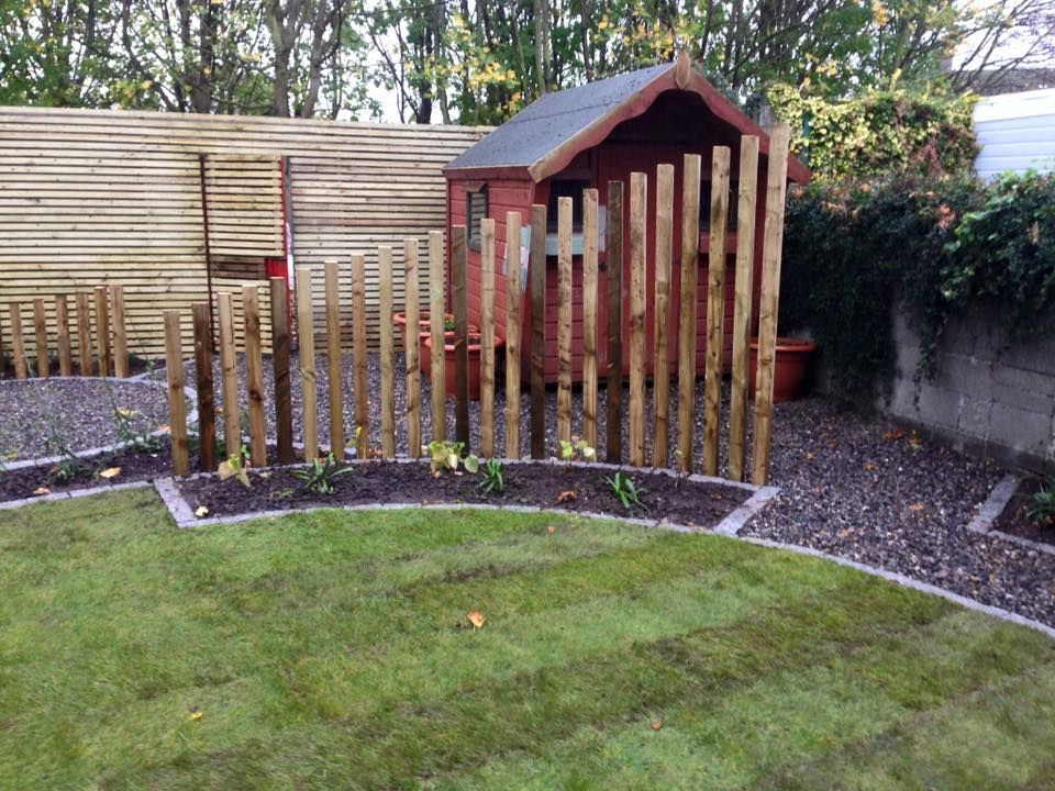 Back garden with hidden shed, using timber sleepers and ...