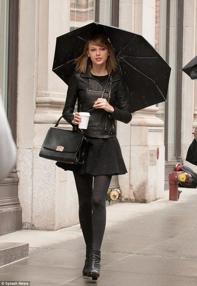 af5199f63ade Singer in the rain  Taylor Swift stepped out in the wet weather in New York  on Saturday to grab a coffee