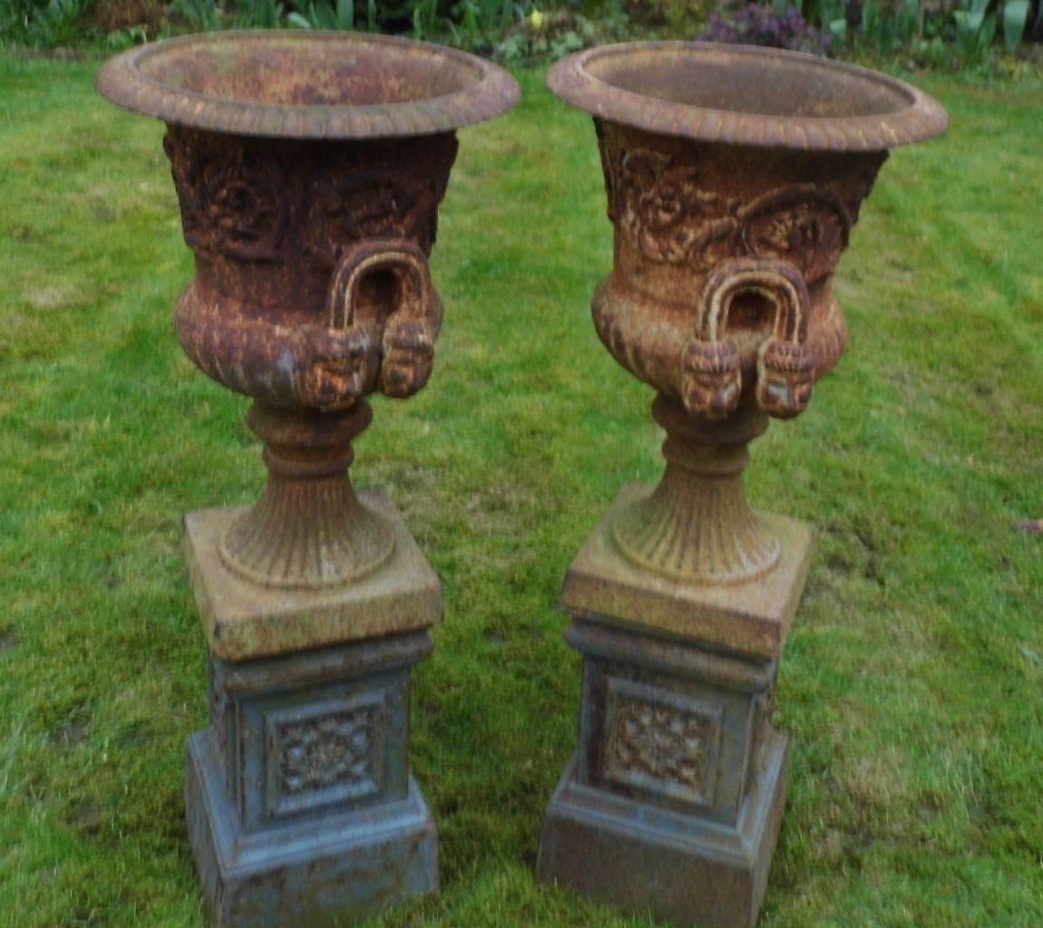 pair of rusty cast iron garden urns antique garden urns