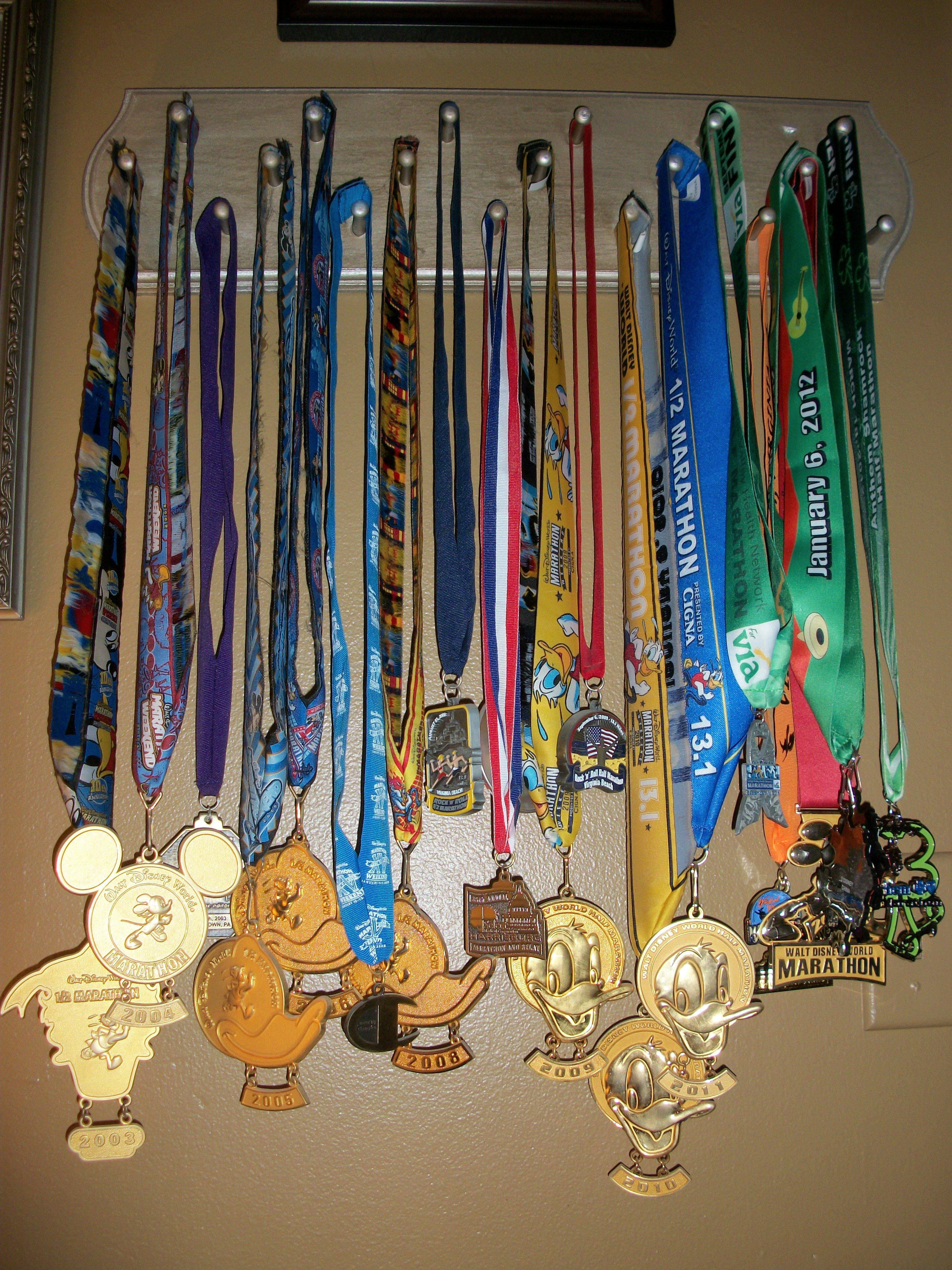 all my running medals displayed on a peg boardeasy to make - Peg Boards