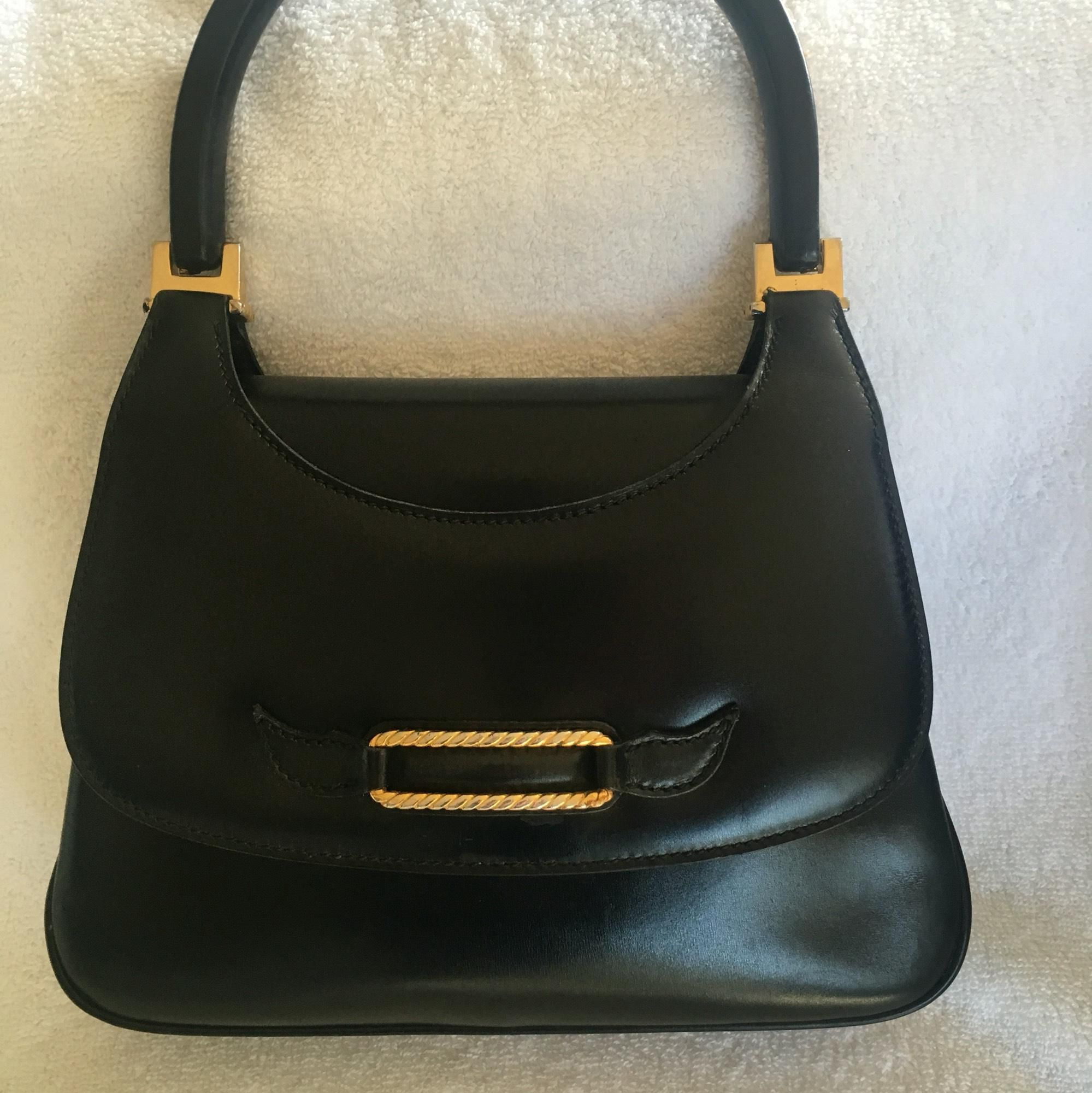1429fbf1348 Save 67% on the Gucci Leather Top Handle - Gold Metal Detail Black Satchel!  This satchel is a top 10 member favorite on Tradesy.