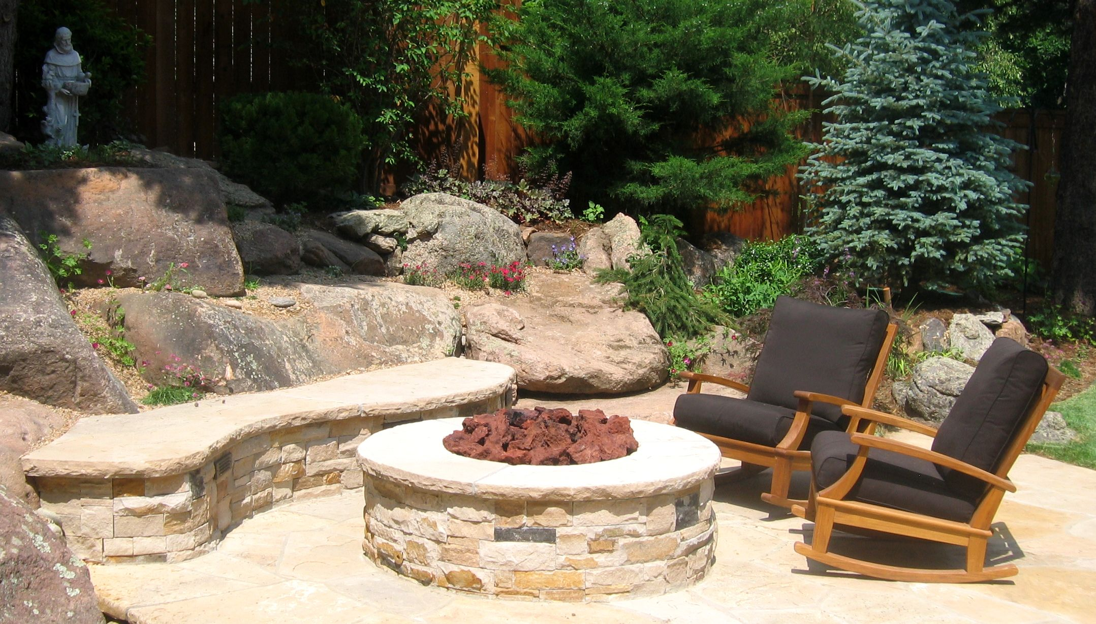 This Stone Fire Pit Matches The Surrounding Seat Walls Blending