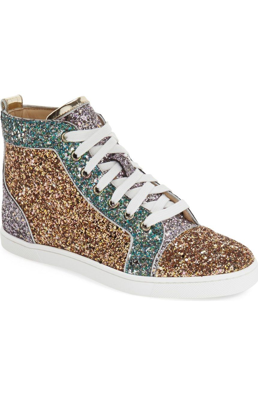 6e76c1e7b3ae Stealing the scene with these Christian Louboutin sneakers in gold and  multi colored glitter.