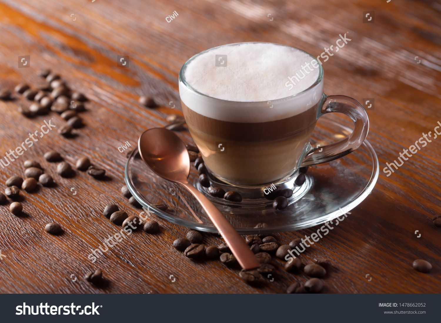 Cup of coffe with milk on a dark background Hot latte or Cappuccino prepared with milk on a wooden table with copy space