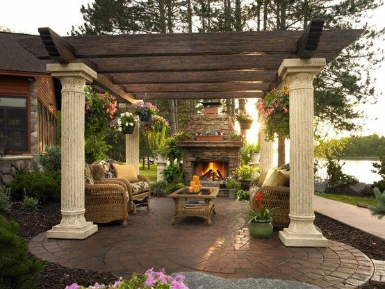 beautiful brick deck with rattan furn- Back porch patio with fire