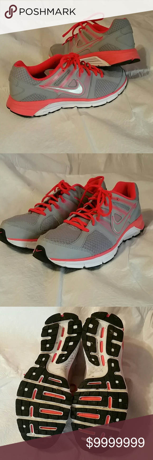 Nike tennis shoes Grey sneaker with bright orange and white detail. Light  tread wear and