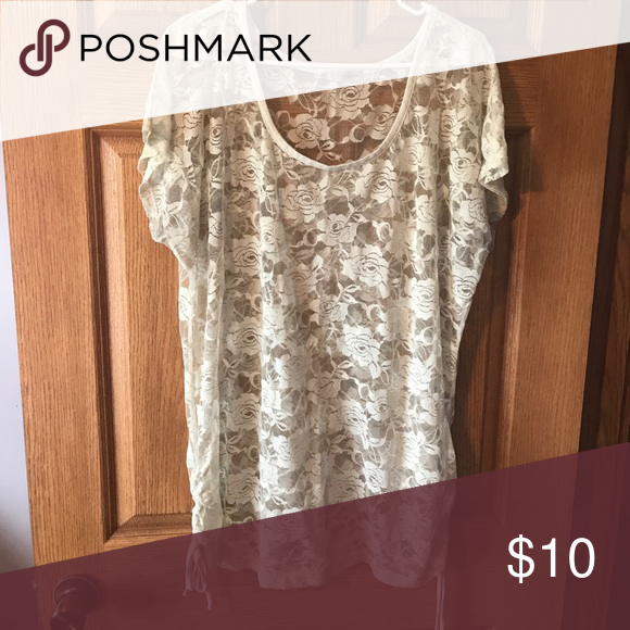Rose lace shirt Super cute rose lace see-through shirt. It fits a little longer, you can wear with a tank top underneath or can use as a bathing suit cover up. Two strings on each side that can be tied and adjusted. It is a size 2 from Maurice's Plus. Maurices Tops Tees - Short Sleeve