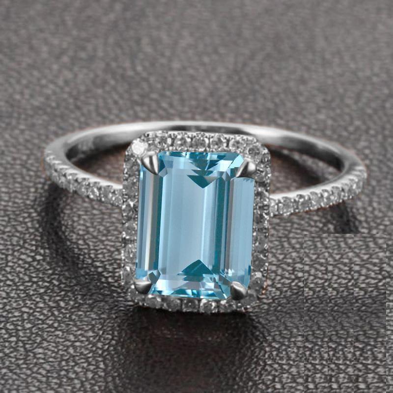 Beautiful 1.50 Carat Emerald Cut Aquamarine and Diamond Halo Engagement Ring in White Gold