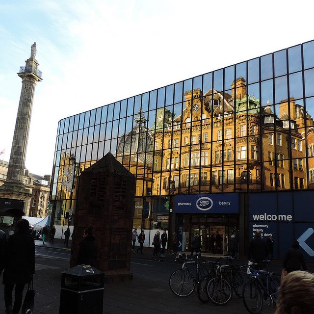Seems reflecting the historical architecture in modern facades in old city/town centers is a common practice in UK. New Castle, the Old Eldon Square