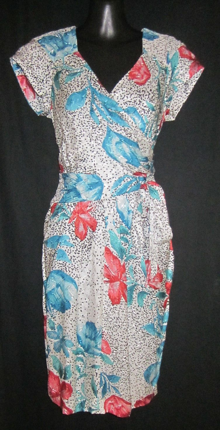 A very classy dress in luxury fabric and stunning print, mock wrap ...