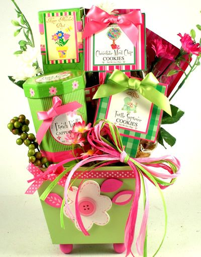 A Gourmet Bouquet Gift Basket for Her     Colorful, bright and full of cheer, this sensational gardening gift basket design offers a cute wooden planter filled with a collection of delicious gourmet gift basket goodies!    http://www.littlegiftbasketboutique.com/item_784/A-Gourmet-Bouquet-Gift-Basket-for-Her.htm