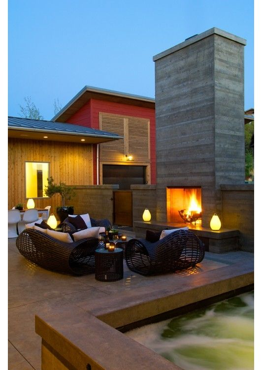 This modern furniture style patio is a great space for relaxing and entertaining! The built in fire pit and comfy furniture complete the look! - Upscale Home and Garden Design Ideas