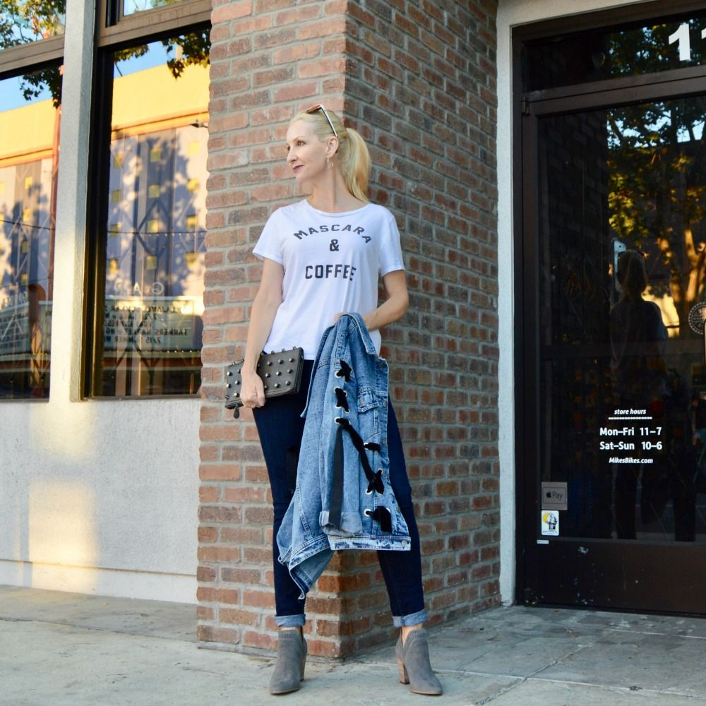 8b6d7abb66 wearing trends over 40, style over 40, denim jacket update, graphic tees  over 40, suede spilt shaft booties, skinny curvy jeans, studded clutch, ...
