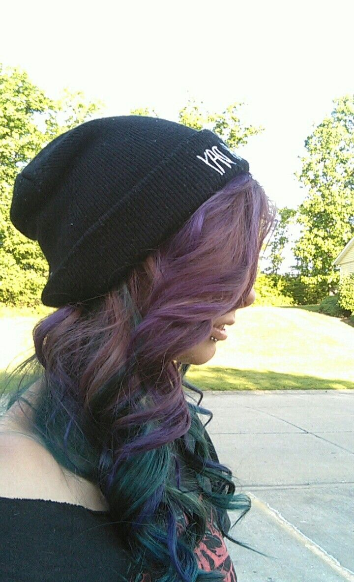 Blue green purple dyed curled hair